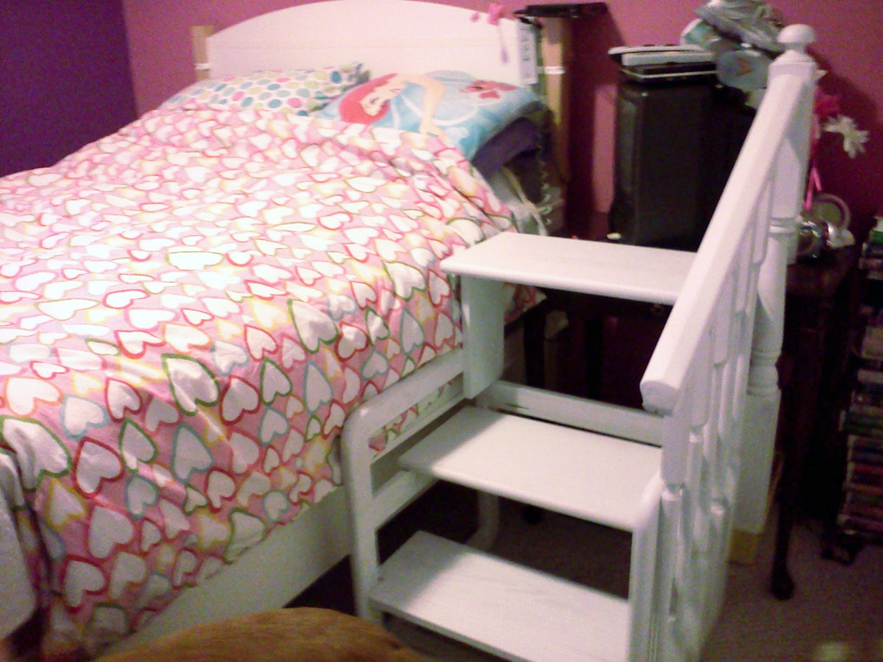 Bed steps beside bed