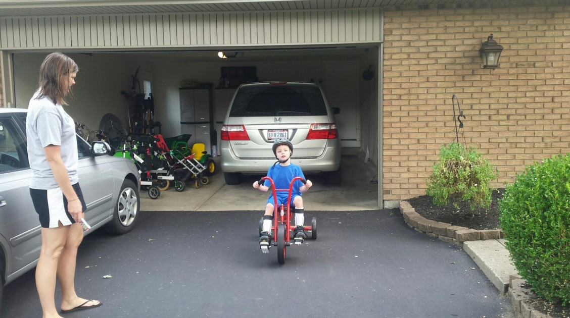 William on his special needs adapted Winther tricycle