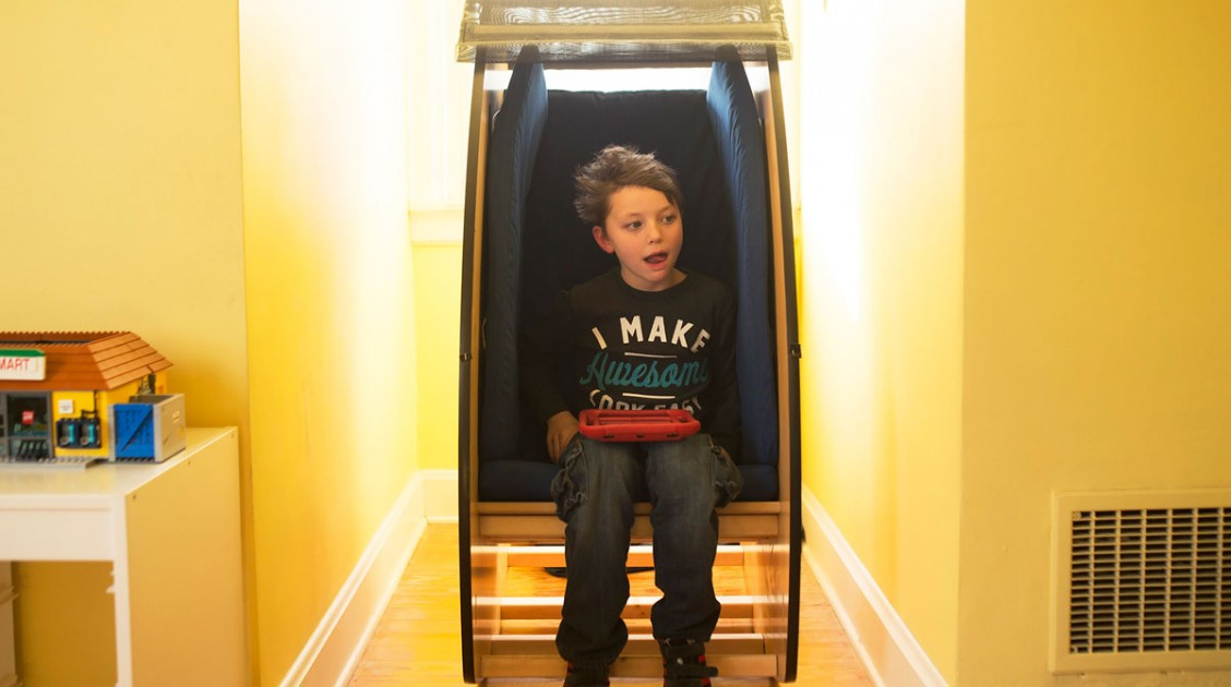 Boy sitting in May We Help Sensory Chair