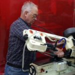 Bill cutting pieces in the workshop