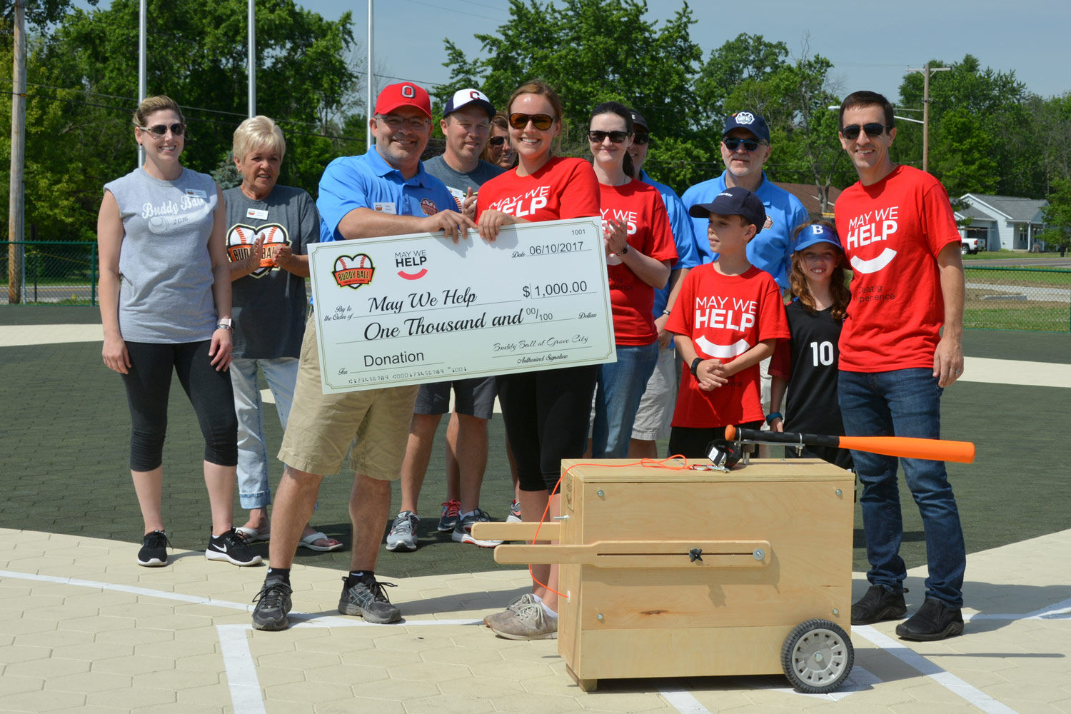 Buddy Ball of Grove City presents a donation to May We Help Columbus.