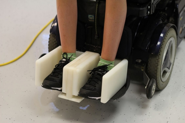 Client's feet in footrest wheelchair adaptation