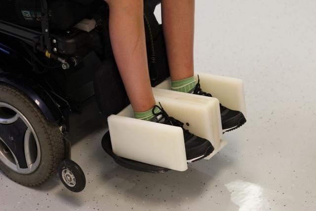 Feet in footrest wheelchair adaptation