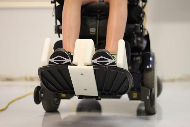 Underside footrest wheelchair adaptation