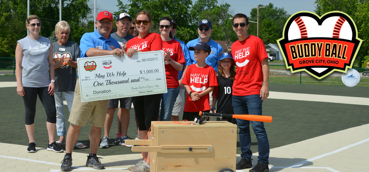 Buddy Ball presents donation to May We Help. Batter Up Machine Donated in kind