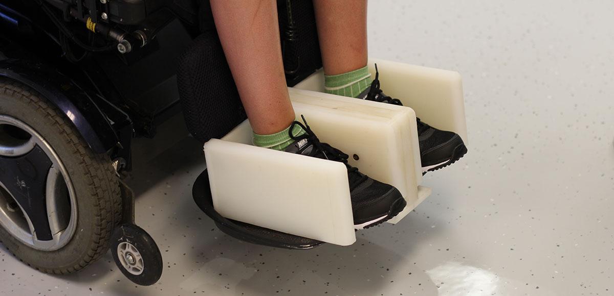 Footrest wheelchair adaptation