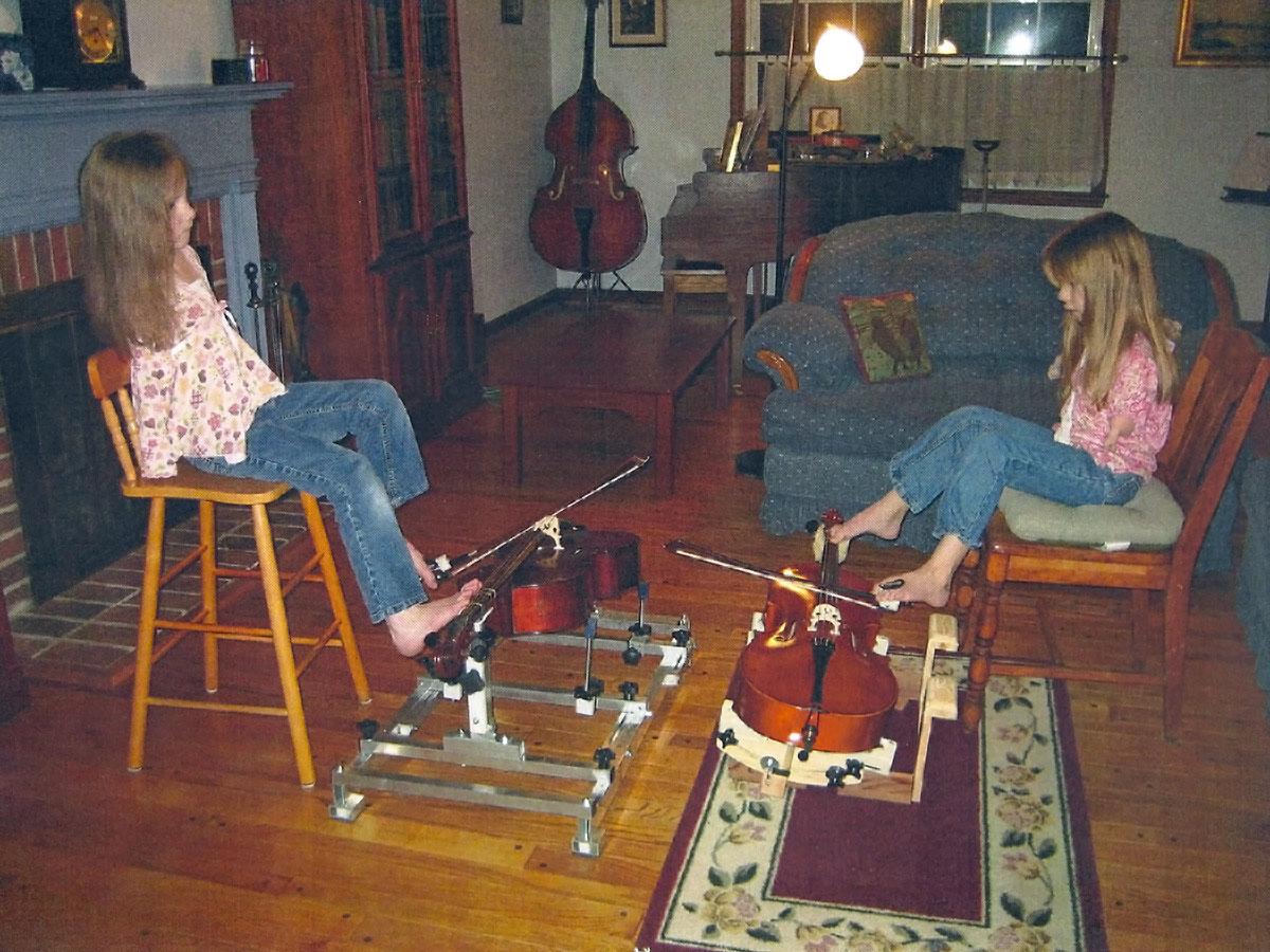 Inga and Elena playing cello at home