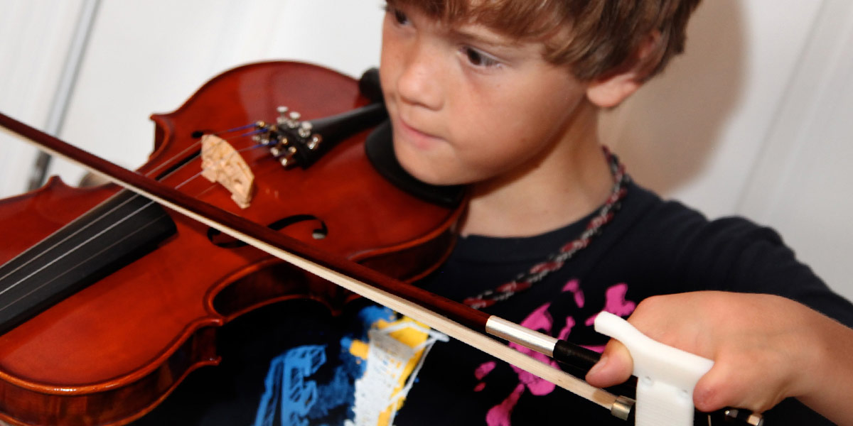 Jack playing violin with bow holder